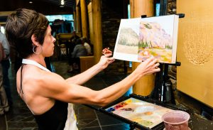 Artist Hadley Rampton offers a painting demonstration at the High Desert Museum.